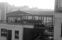 楼顶私盖阳光房,面积相当于一套房(图)