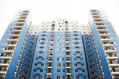 村民洗脚上楼,住上高层楼房是城镇化发展的趋势,也是江南区提高农民